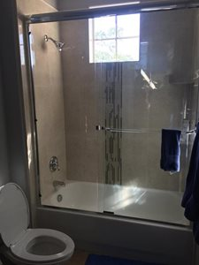 Updated shower with update tile and mosaic tile detail!