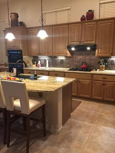 New floor tile and backsplash to liven up the kitchen!